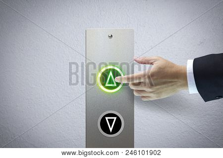 Hand of a man pressing the elevator button for next levels up in concept of more advance to a success. poster