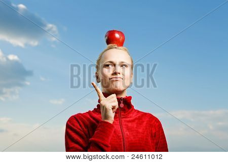 Pretty Young Woman Holding Apple on The Head