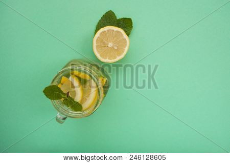 Top View Of Mason Jar Glass Of Lemonade Or Mojito With Lemons And Mint. Summer Fresh Cocktail.