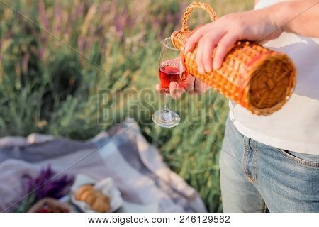 Man's Hands With Bottle Of Wine, Pour Wine Into Wineglass