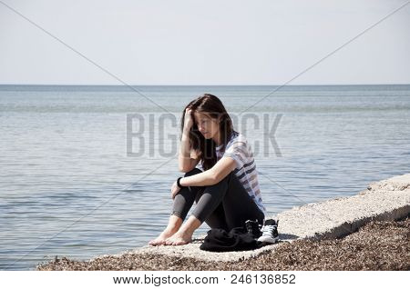 Loneliness And Thinking About Future. Waiting For Better Time. Woman Relax On Sea Shore. Summer Holi