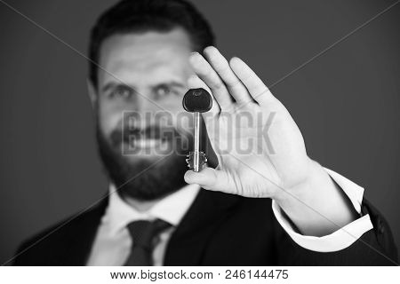 Key Decision. Key In Hand. Businessman Or Man With Key In Suit On Blue Background, Deposit And Credi
