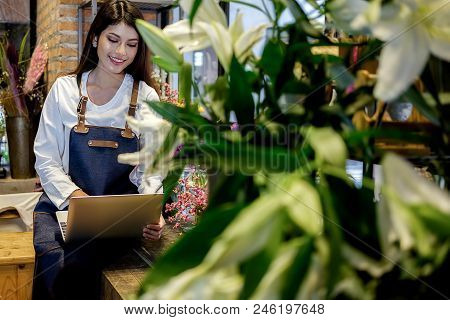 Cheerful Charming Young Business Owner Flower Shop Store Florist Standing And Holding Flowers