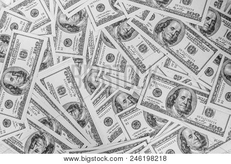 A Pile Of One Hundred U.s. Dollars Banknotes Of The United States Of America. Cash Of Hundred Dollar