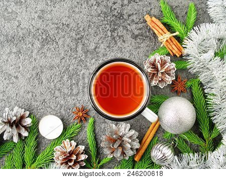 Christmas And Happy New Year Background With Tea. Top View, Copy Space. Fir Branches, A Silver Concr