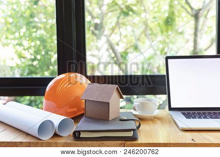 Engineer And Architect Concept, Engineer Architects And Real Estate Agent Office With Blueprints