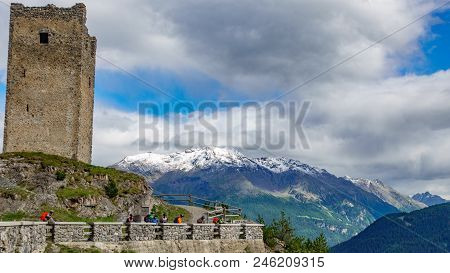 Towers Of Fraele With Tower In The Foreground And Snow Over Mountain Peaks, A Touristic Attraction I