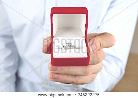 Engagement / Marriage / Wedding Proposal Scene. Close Up Of Man Handing The Expensive Gold Platinum