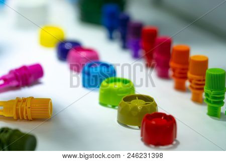Selective Focus On Different Type Of Plastic Bottle Cap Of Food And Drink Product. Green, Yellow, Re