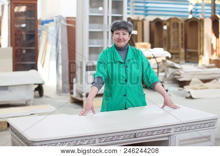Belarus, The City Of Gomel, On April 26, 2018. Furniture Factory. A Woman Is An Employee Of A Furnit