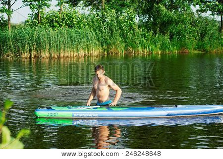 A Man Practicing With Sap Board, Water Activities, Extreme Hobby