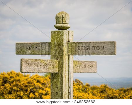 A Signpost on the South Downs Way between the Clayton windmills and Ditchling Beacon, showing the directions for Brighton, Keymer, Eastbourne and Winchester.