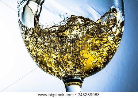 White Wine Splash On Grey Background, Stream Of White Wine Pouring Into A Glass. White Wine Splash O