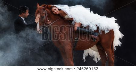 Young Newlywed Couple, Beautiful Beauty Bride In Fashion White Bridal Wedding Costume Riding On Stro