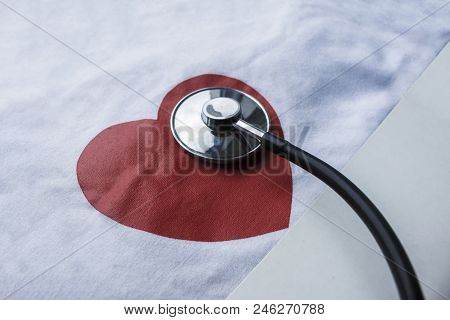 Medic Stethoscope And Red Heart Drawn On White Canvas Background With Copy Space
