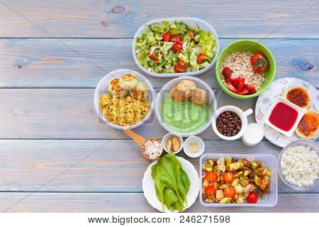 Health And Fitness Food In Lunch Boxes. Set Meal For The Whole Day