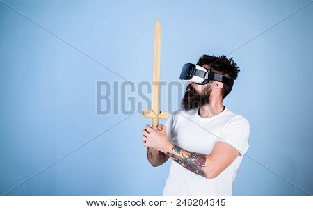Hipster On Serious Face Enjoy Play Game In Virtual Reality. Gamer Concept. Man With Beard In Vr Glas