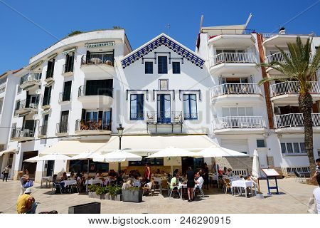 Sitges, Spain - May 23: The Tourists Enjoiying Their Vacation In Outdoor Restaurant On May 23, 2015