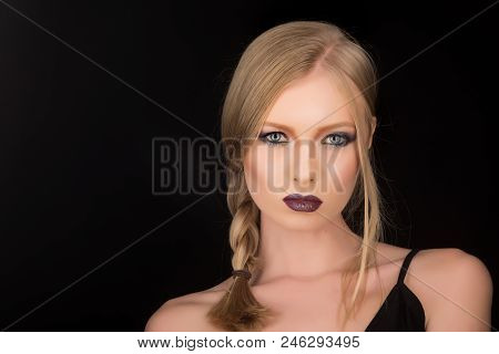 Fashion Model With Makeup And Stylish Hairdo. Sexy Woman With Blonde Hair Isolated On Black. Hairdre