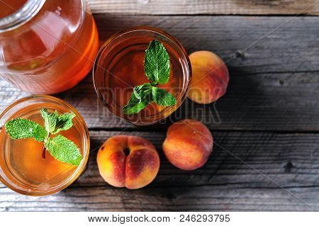 Fresh Homemade Peach Sweet Tea With Mint Top View.