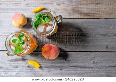 Fresh Homemade Peach Sweet Tea With Mint Top View In Mason Jar
