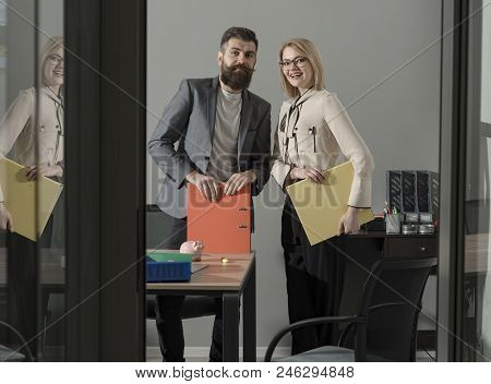 Working And Communicating Together. Happy Colleagues In Modern Office. Business Couple Smile Meeting