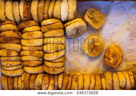 Dried Figs In A Box On Parchment Paper For Transportation And Sale, Floral Background