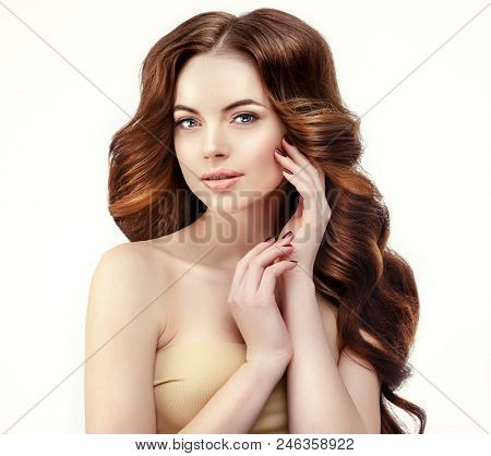 Beauty Fashion Model with long shiny  hair. Waves & Curls volume Hairstyle.  Salon. Updo. Woman with healthy haircut girl with luxurious Updo. Hair loss.