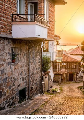 Old residential street in Sozopol, Bulgaria at sunset