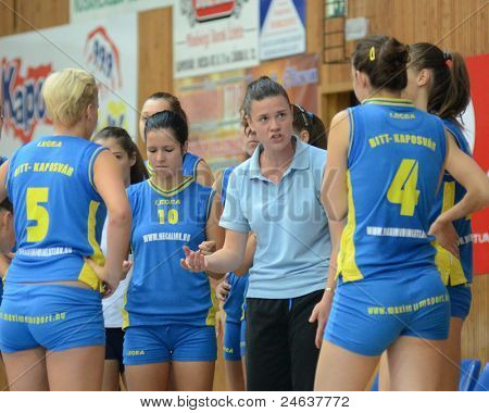 KAPOSVAR, HUNGARY - OCTOBER 2: Kaposvar players listening to trainer at a Hungarian NB I. volleyball game Kaposvar (yellow number) vs Tatabanya (white number), October 2, 2011 in Kaposvar, Hungary.