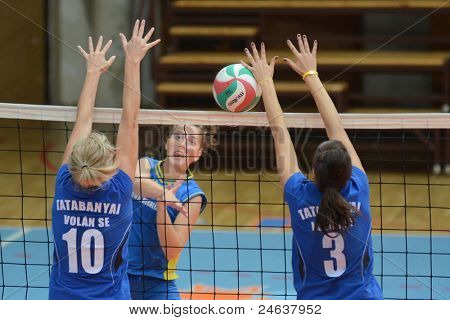 KAPOSVAR, HUNGARY - OCTOBER 2: Karmen Kovacs (C) in action at a Hungarian NB I. League volleyball game Kaposvar (yellow number) vs Tatabanya (white number), October 2, 2011 in Kaposvar, Hungary.
