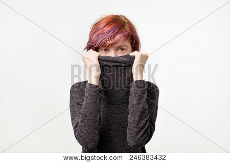 Anonymous Concept. Young Woman With Interesting Colorful Hairstyle Hiding Her Face With Colar. She D