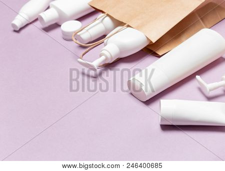 Various Cosmetic Products With Paper Packaging Bag. Beauty Shopping Concept. Shallow Depth Of Field,