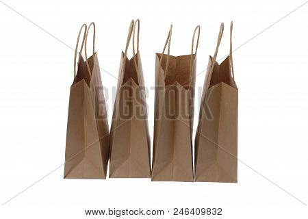Brown Paper Shopping Bags On White Background. Empty Area.