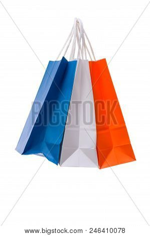 Variety Of Colored Paper Shopping Bags On White Background. Colors Of The France Flag.