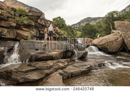Royal Natal National Park, South Africa - March 14, 2018: Unidentified Tourists At The Cascades In T