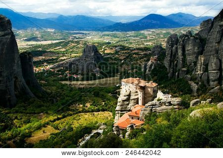 incredible sandstone rock formations and the Holly Monastery of Rousanou and St. Nikolaos Anapafsas Monastery in background. The Meteora area is on UNESCO World Heritage List since 1988