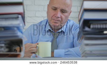Businessperson In Office Room Take A Pause Drinking Coffee