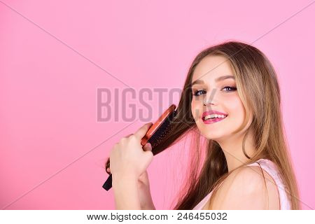Sexy Woman Comb Long Straight Hair. Girl With Hair Brush On Pink Background. Fashion Model Brush Her