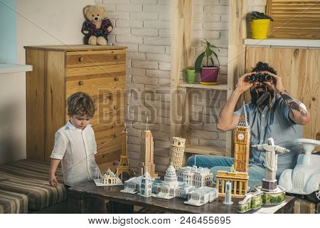 Ready To Big Travel. Little Child And Man With Binocular And Miniature Architecture. Boy Son And Fat