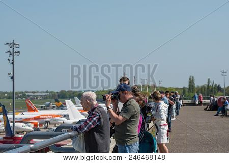 Berlin Germany - April 21. 2018: Berlin Germany - April 21. 2018: Airplane Spotters Looking At Airpl