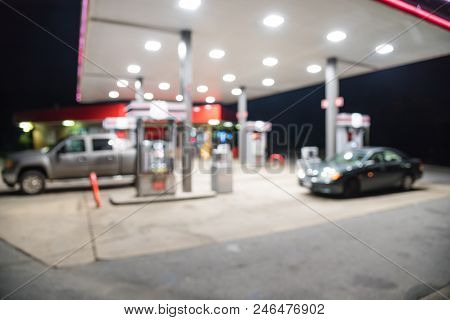 Abstract Blurred Gas Station With Car Refueling At Night