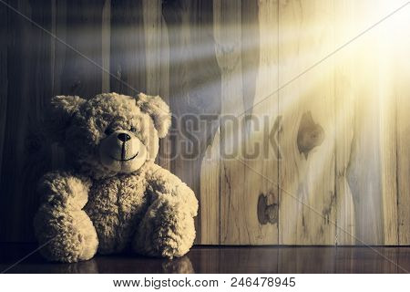 Lonely Teddy Bear Sitting Alone On Wooden Table And Sunlight Effect