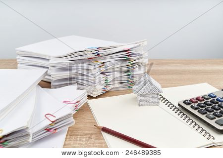 House On Notebook With Calculator White Background And Copy Space