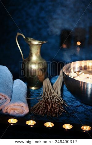 Scenery Baths Hammam, Spa Procedures. Copper Jug, Bowl With Burning Candles, White Towels
