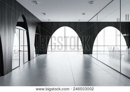 Modern Office Lobby With A Concrete Floor, Arched Dark Wooden Walls And Panoramic Windows. 3d Render
