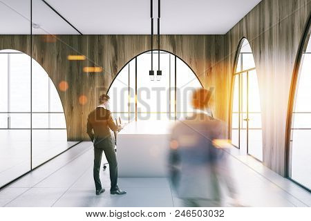 Modern Office Meeting Room Interior With A Concrete Floor, Arched Wooden Walls And Panoramic Windows
