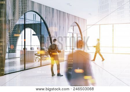 Business People In A Modern Office Lobby With A White Floor, Arched Light Wooden Walls And Panoramic