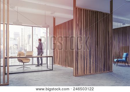 Interior Of A Manager S Office With Wooden Walls, Panoramic Windows, A Table And A Yellow Chair. A B