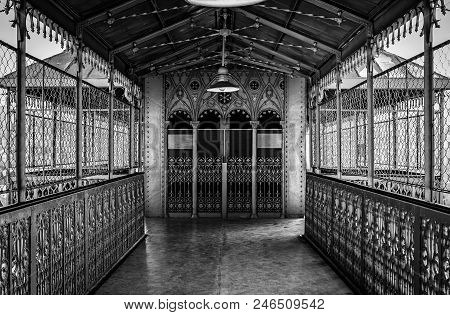 Metallic And Deep Corridor, Detail Of A Hall With Elevator To The Background, Old
